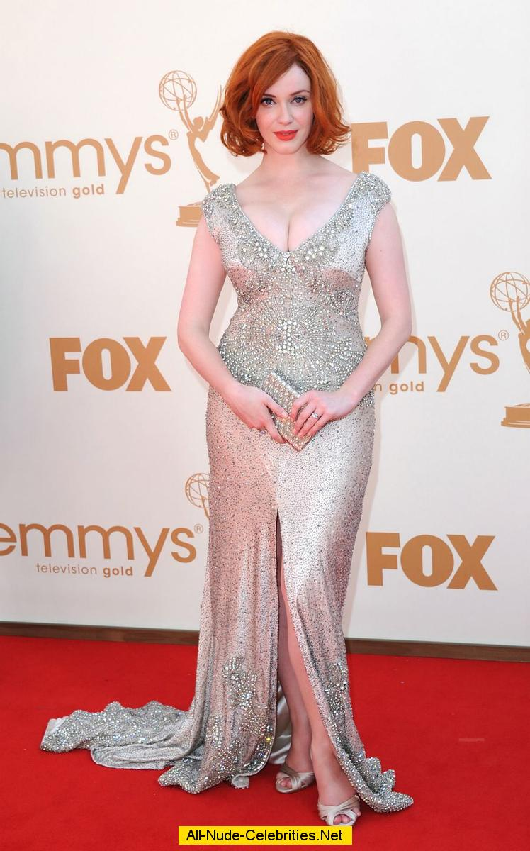 Busty Christina Hendricks shows cleavage at Emmy Awards