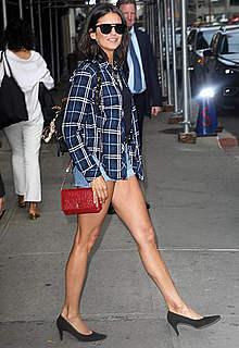 Nina Dobrev in tiny shorts shows her long legs