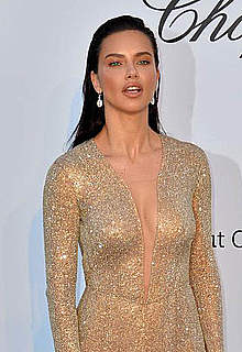 Adriana Lima in tight see thru dress at amfAR