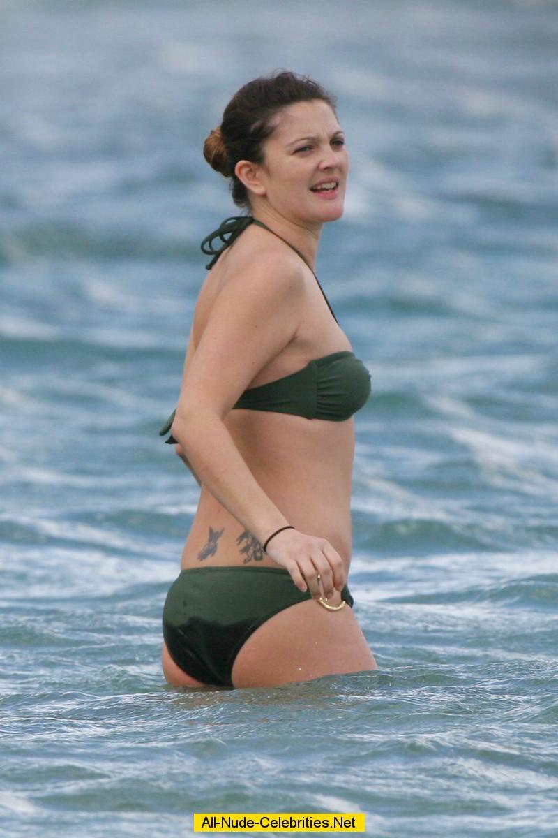 Drew Barrymore in bikini on the beach in Hawaii: www.starzhunter.com/d/drew_barrymore_19/scandal.html