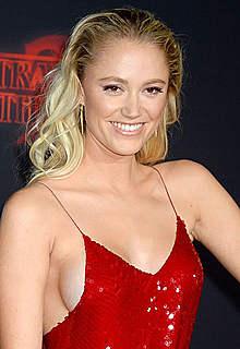 Maika Monroe sideboob in red dress at premiere